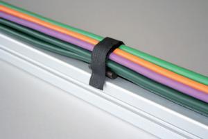 Prinderea cablurilor, firelor si conductelor in manunchiuri care sunt dirijate si fixate intr-un mod sigur, rapid si rentabil.